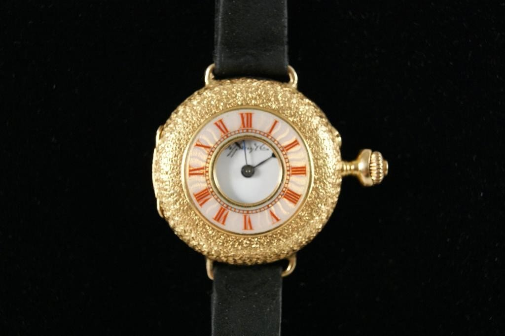 14: 18kt? yellow gold Tiffany & Co. watch with