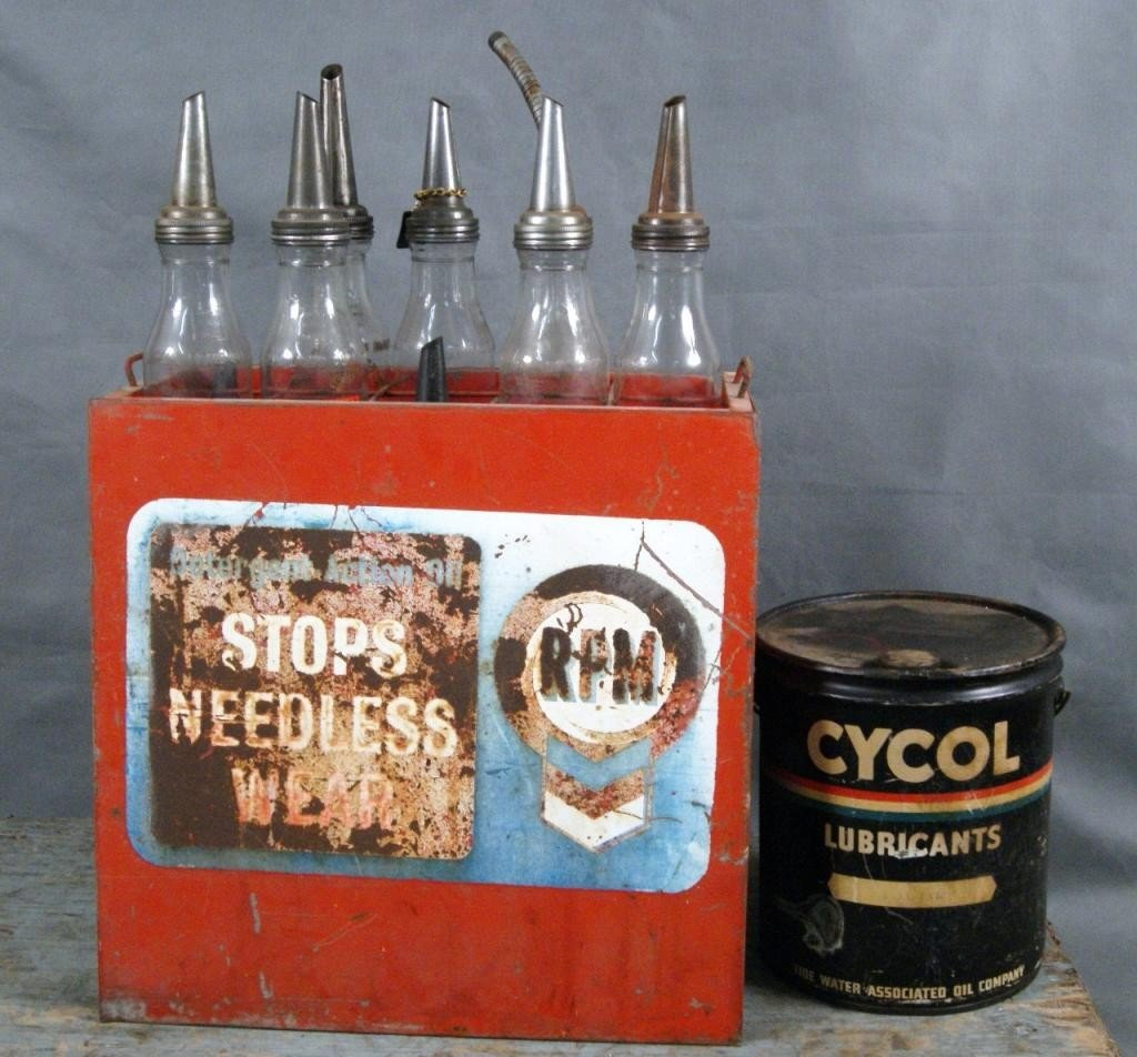 19: Collection of vintage motor oil jars & stand
