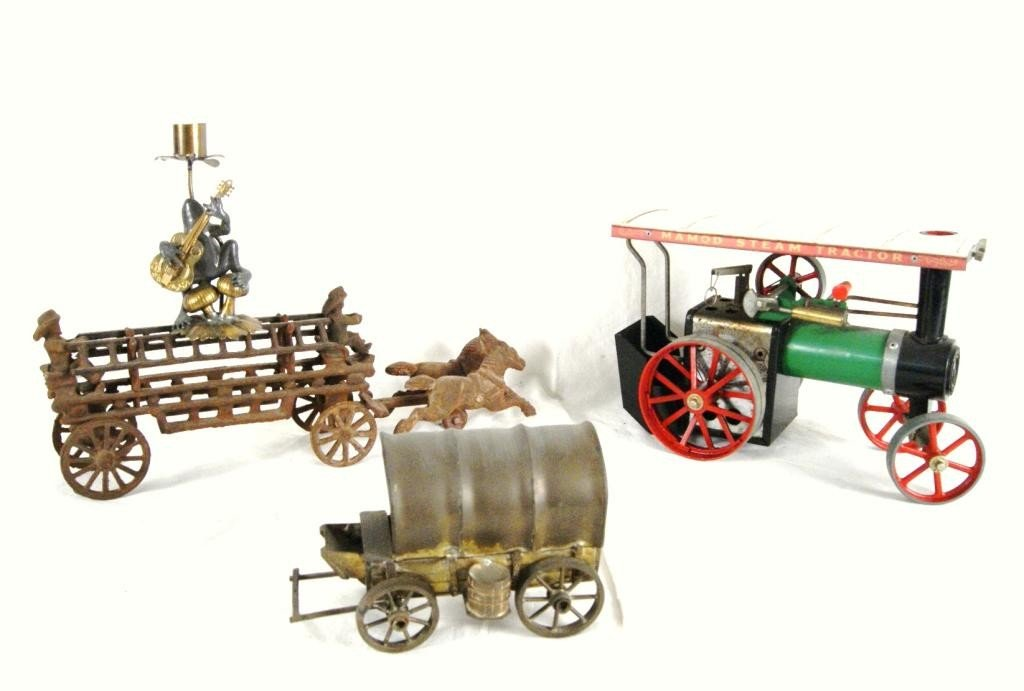 23: Steam engine,  cast iron toy covered wagon