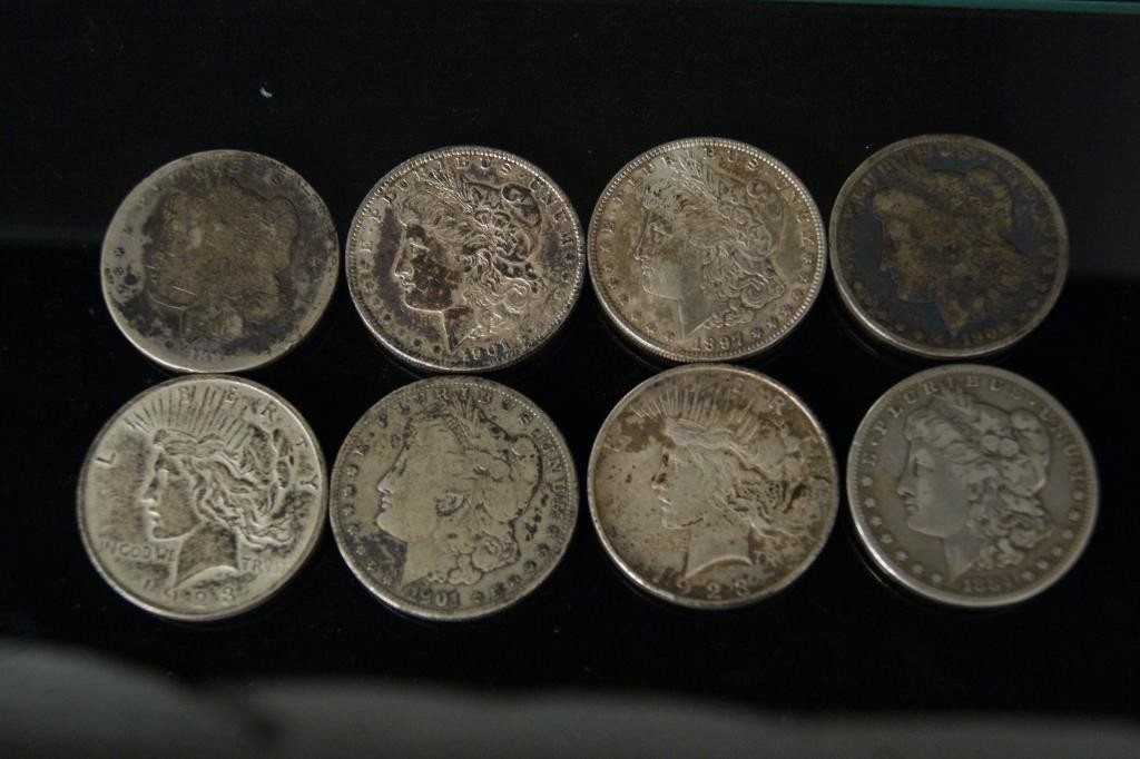 35: 8 - 1898 US silver dollars without cases