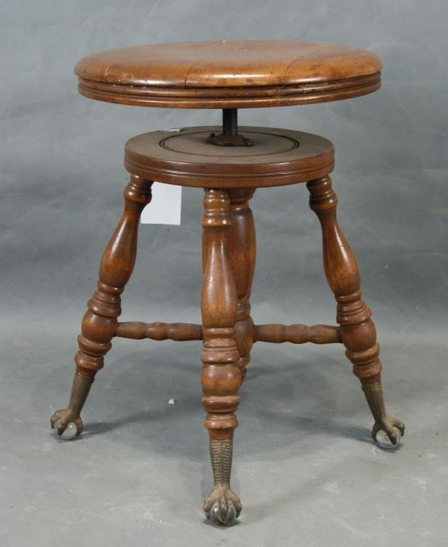 42: Antique claw foot Piano stool
