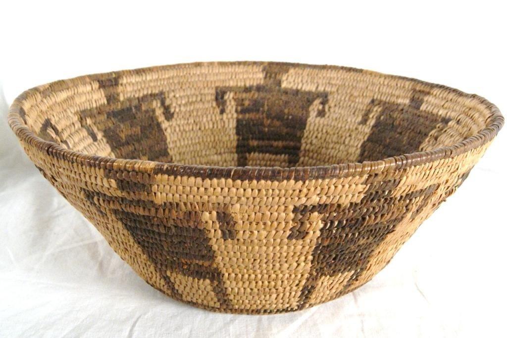 "70: Pima basket with figures - 10""d  3.5""h"