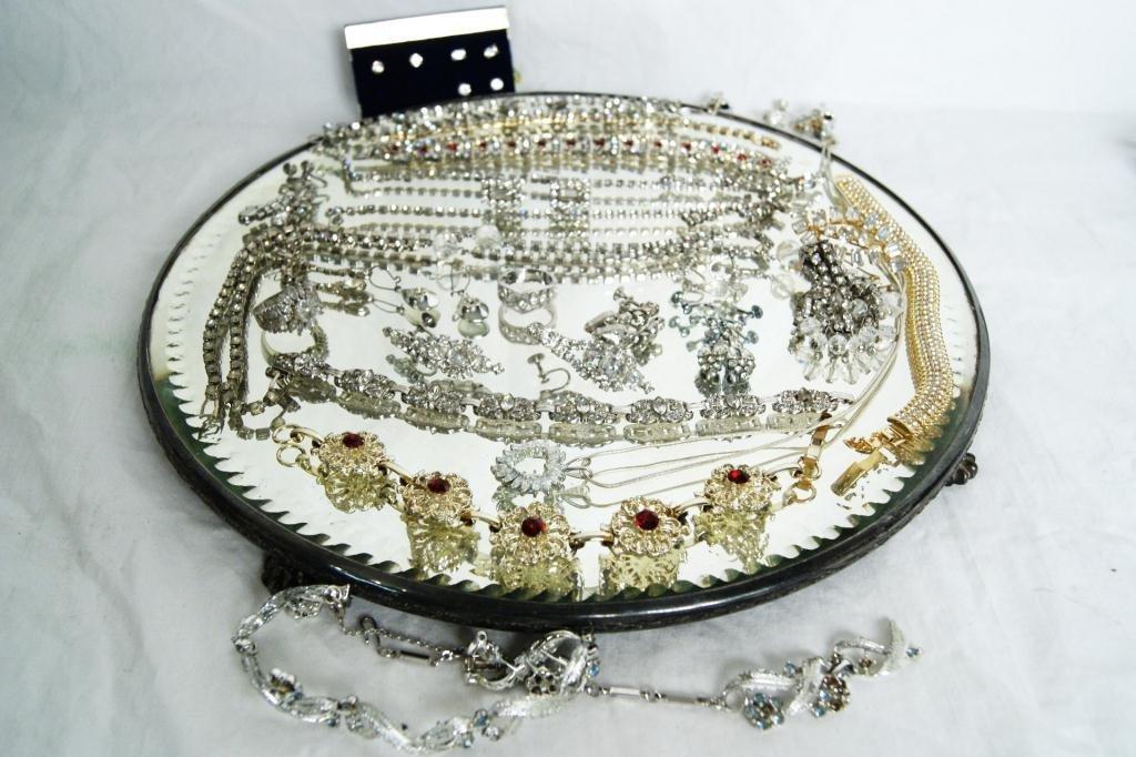 14: Lot of rhinestone jewelry, cz's, earrings, bracele