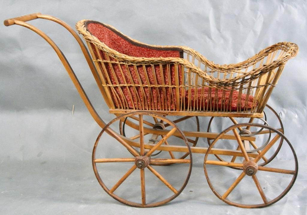 22: 19th c Wicker doll carriage w wooden spoke wheels