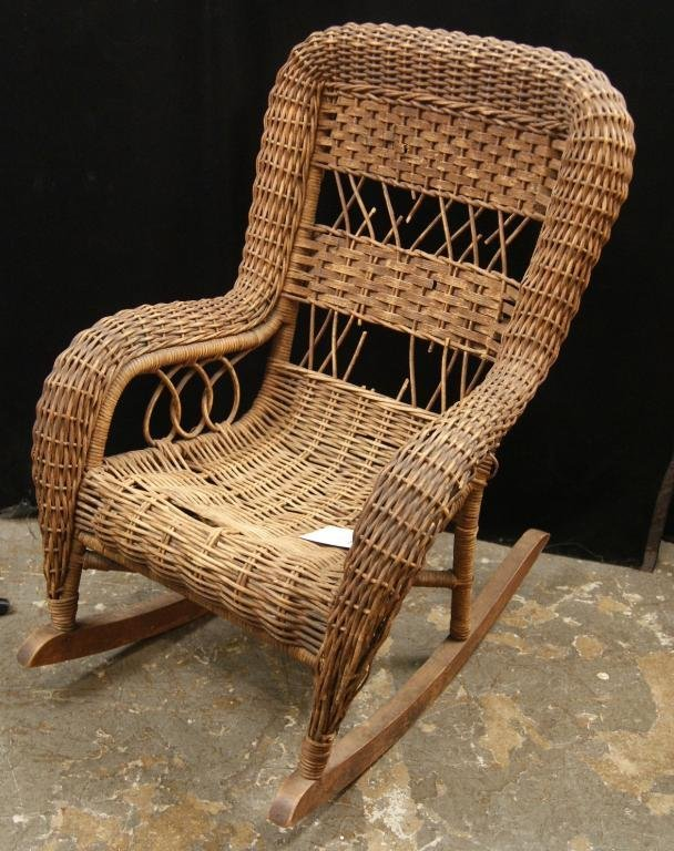 23: Antique Child's wicker rocker