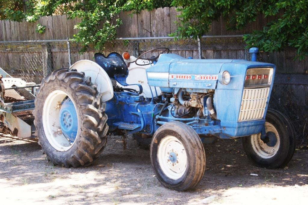 77: Ford tractor with hydraulic dump trailer