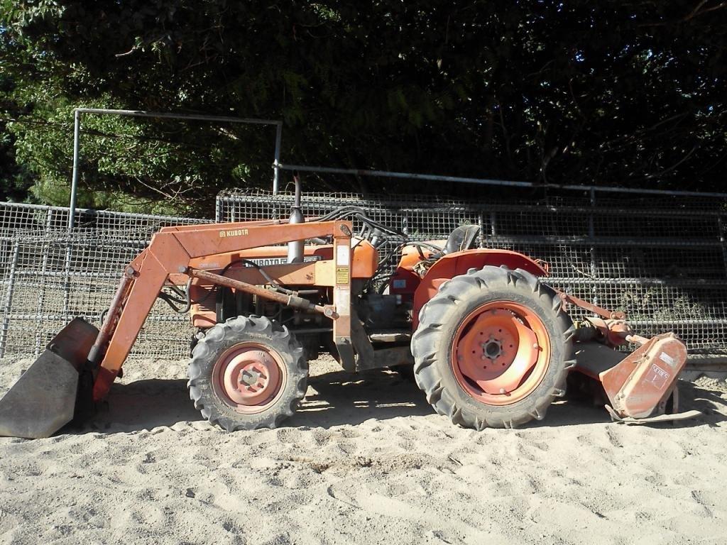 78: Kubota L245D tractor front loader & 3 pt. blade