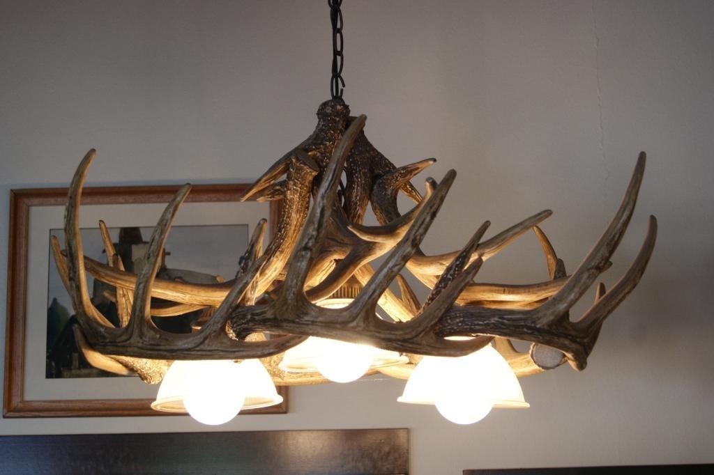 83: Pair of hanging 3-light antler chandeliers