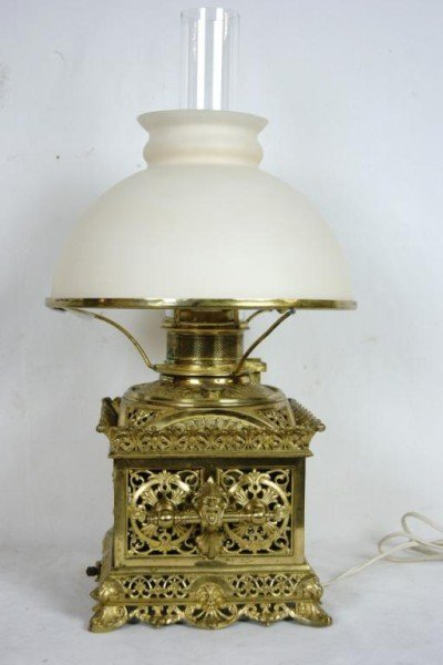 21: 19th c Brass filigree embossed lamp w figures