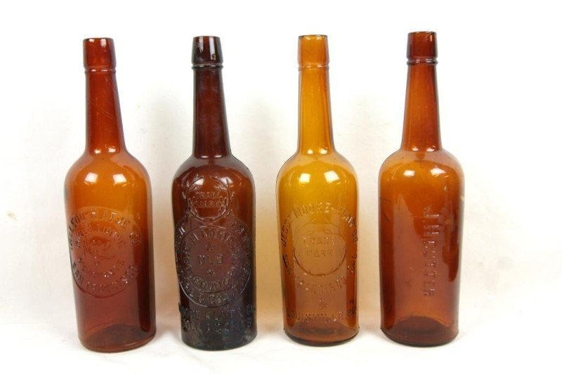 409: 4 Amber Glass Antique whiskey bottles