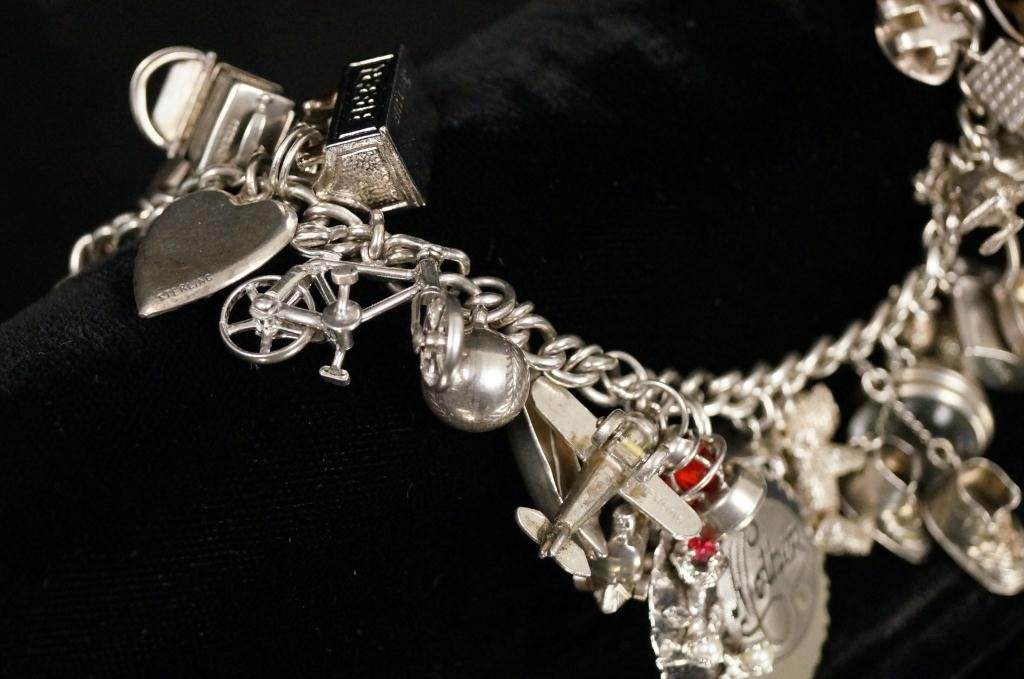 Charm bracelet - approx 20+ sterling charms