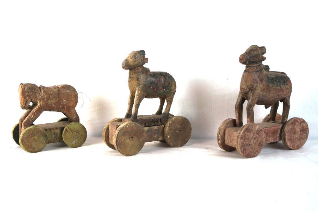 Three Antique wood carved child's pull toys