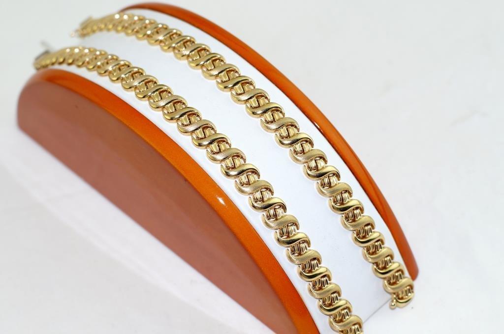 Pair of 14kt Italian designer Bracelets