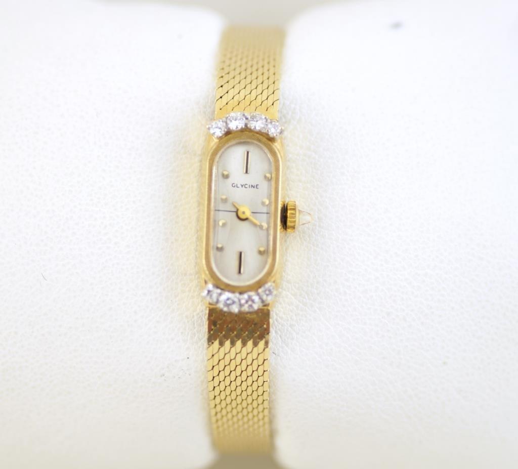 14kt  Glycine ladies gold watch w diamonds