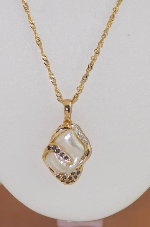 14kt y.g. Pearl pendant & chain - baroque