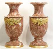 French Pink marble urns with figured gilt bronze
