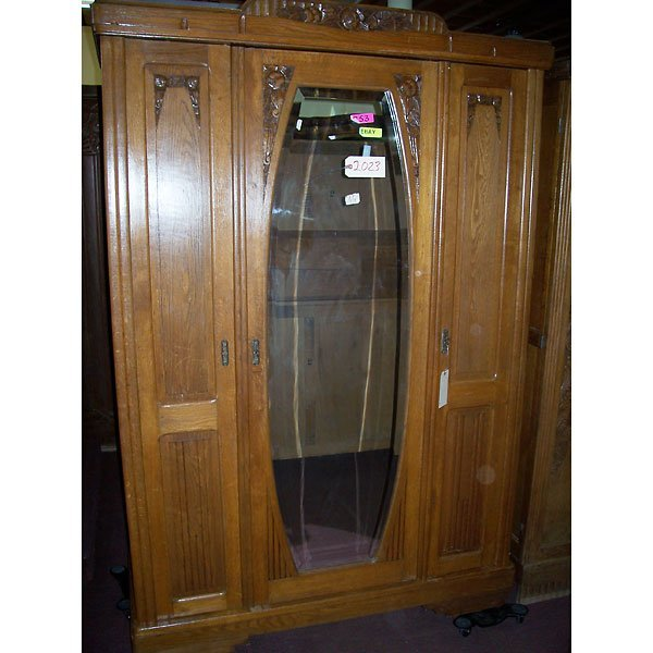 4021: Antique Hand Carved Armoire with Beveled Mirror
