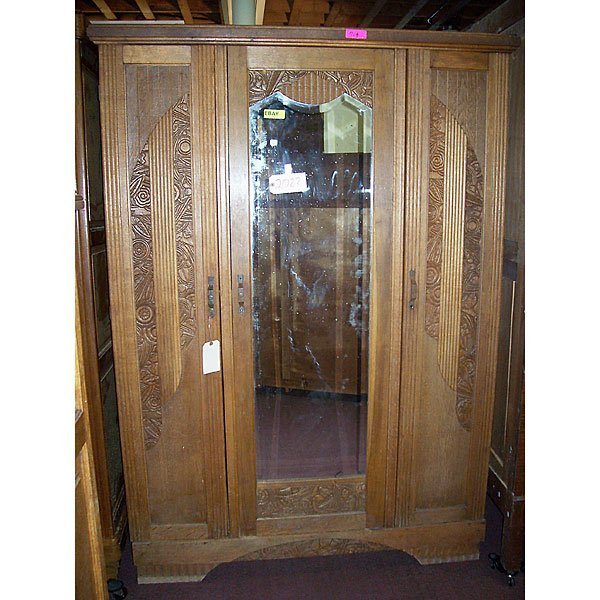 4022: Antique Hand Carved Armoire with Beveled Mirror