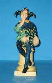 222L: Royal Doulton figure A Jester HN71, by C J Noke,
