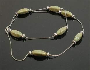 Polished dark green stone necklace: