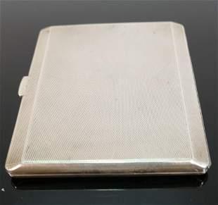 Silver cigarette case, hallmarked for London 1934: