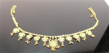 Asian yellow coloured metal ornate necklace: set with