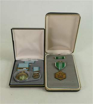 Two boxed US Army military medals: Comprising