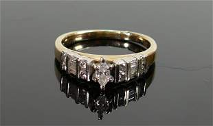 14ct gold diamond ring: Centre oval diamond surrounded