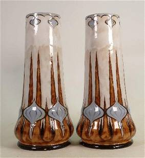A Pair of Royal Doulton Lambeth vases: With stylised