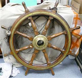A really fine large teak and brass ships wheel: