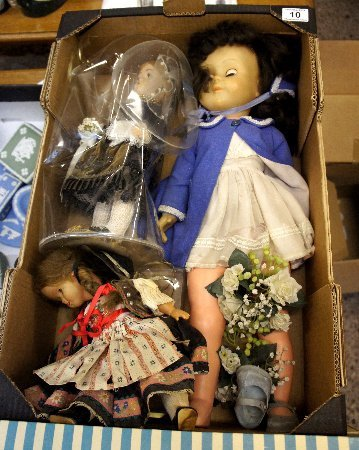 A collection of old dolls and various European costumes