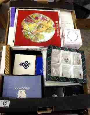 A collection of various boxed pottery and glassware to