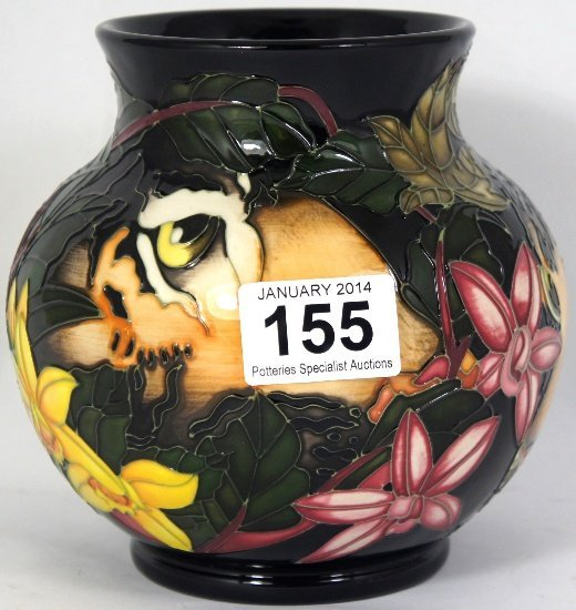 Moorcroft vase decorated with Lions heads in the Hidden