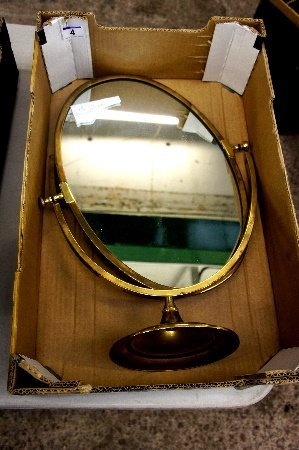 A large ornate brass free standing mirror