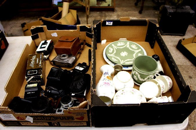 A collection of various items to include cameras,