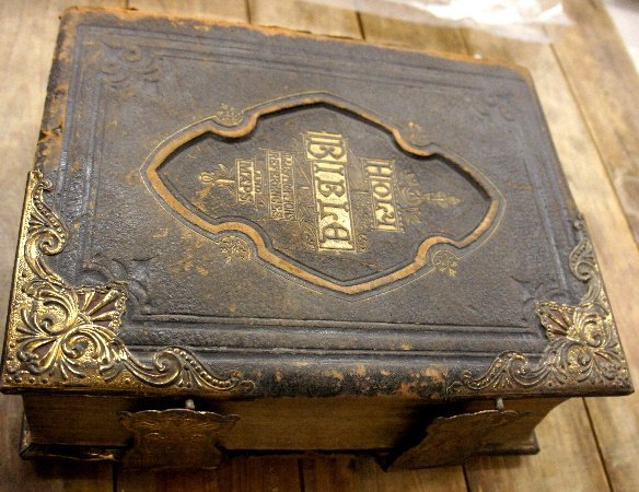 Large 19th Century Holy Bible with guilded metal edges