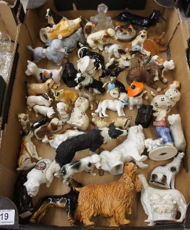 Collection of various pottery dog figures to include