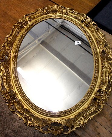 A Large Guilt oval wall mirror 91cm by 70cm