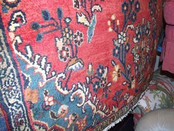 1B: A hand knotted Hamadan carpet the red field floweri