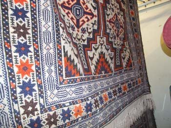 2B: A fine hand knotted Persian Belouch rug the camel f