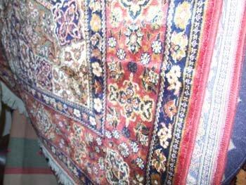 9B: A Persian design Madras carpet the multi coloured f
