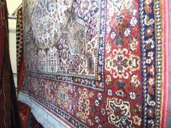 14B: A Persian design Madras rug the multi coloured fie