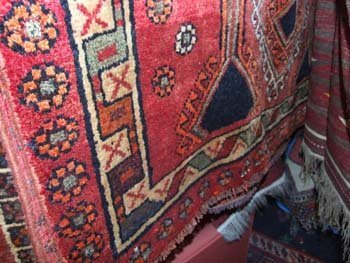 21B: A hand knotted Persian Shiraz carpet the red field