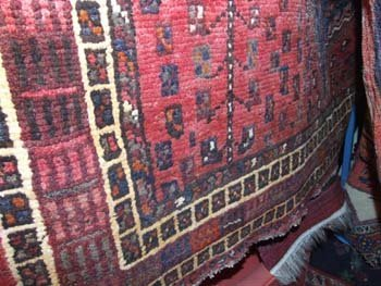 22B: A hand knotted Persian Quashgai carpet the red fie