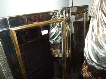125B: A pair of Art Deco style slimline mirror with inc