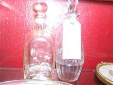 260B A Georgian glass decanter with stopper and a Blac