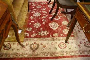 5C: A hand knotted Ziegler carpet  the red ground with