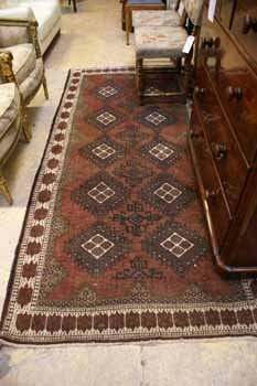 8C: A hand knotted Turkoman rug with geometric repeatin