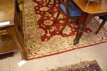 11C: A hand knotted Ziegler rug  the red ground with le