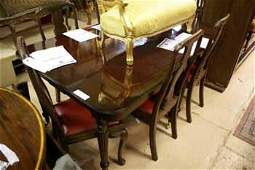 587C: A Georgian style mahogany D-end dining table with